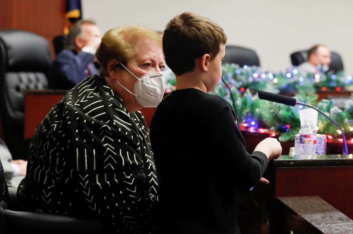 Marsha Porter, left, visits with her seven-year-old grandson, Hunter Biller, before being sworn into Conroe City Council by former Montgomery County Judge Jimmie Edwards at Conroe Tower Tuesday, Dec. 22, 2020, in Conroe. The former Conroe councilwoman won the seat over Kelley Inman following a runoff election on Dec. 15. Porter fills unexpired term of newly-elected Mayor Jody Czajkoski. Only 2,197 out of 49,155 registered voters cast a ballot in the runoff with Porter receiving 1,367 of those votes to Inman's 826.