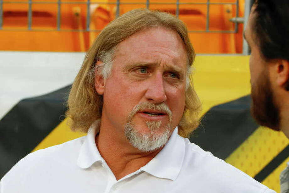 Hall of Fame linebacker Kevin Greene stands on the sideline during warmups before a Sept. 30, 2019 game between the Pittsburgh Steelers and the Cincinnati Bengals in Pittsburgh. The Granite City native died Monday at age 58.