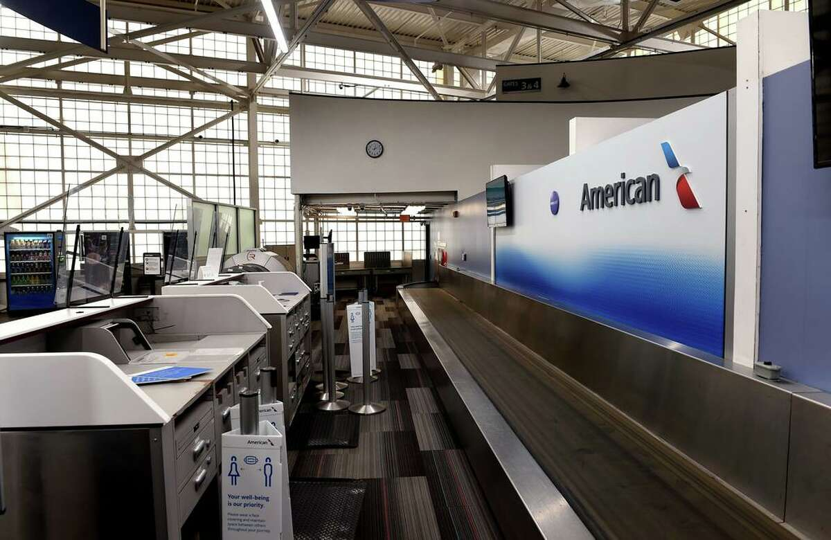The empty American Airlines check-in area in the terminal at Tweed New Haven Regional Airport in New Haven on December 21, 2020.