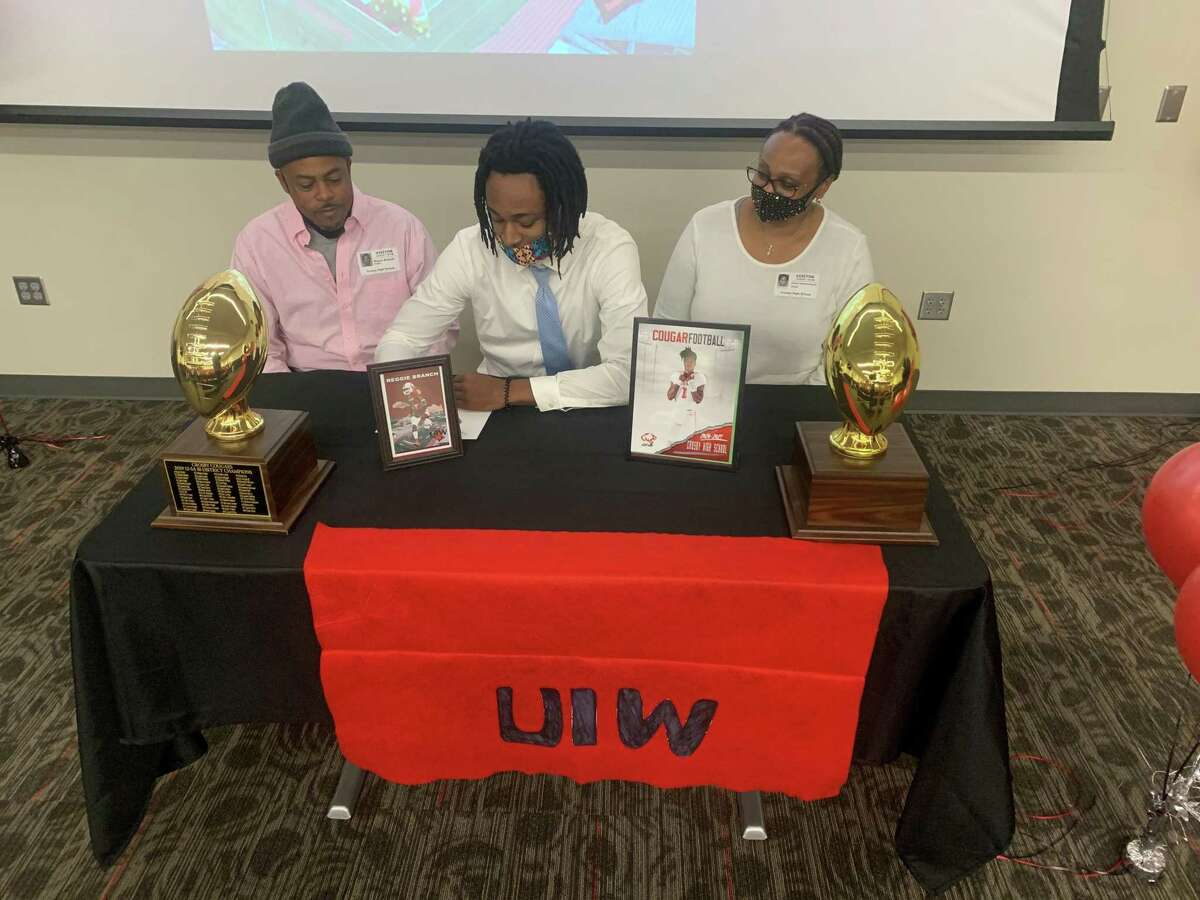 Crosby Reggie Branch signs with Incarnate Word on early National Signing Day at Crosby High School.