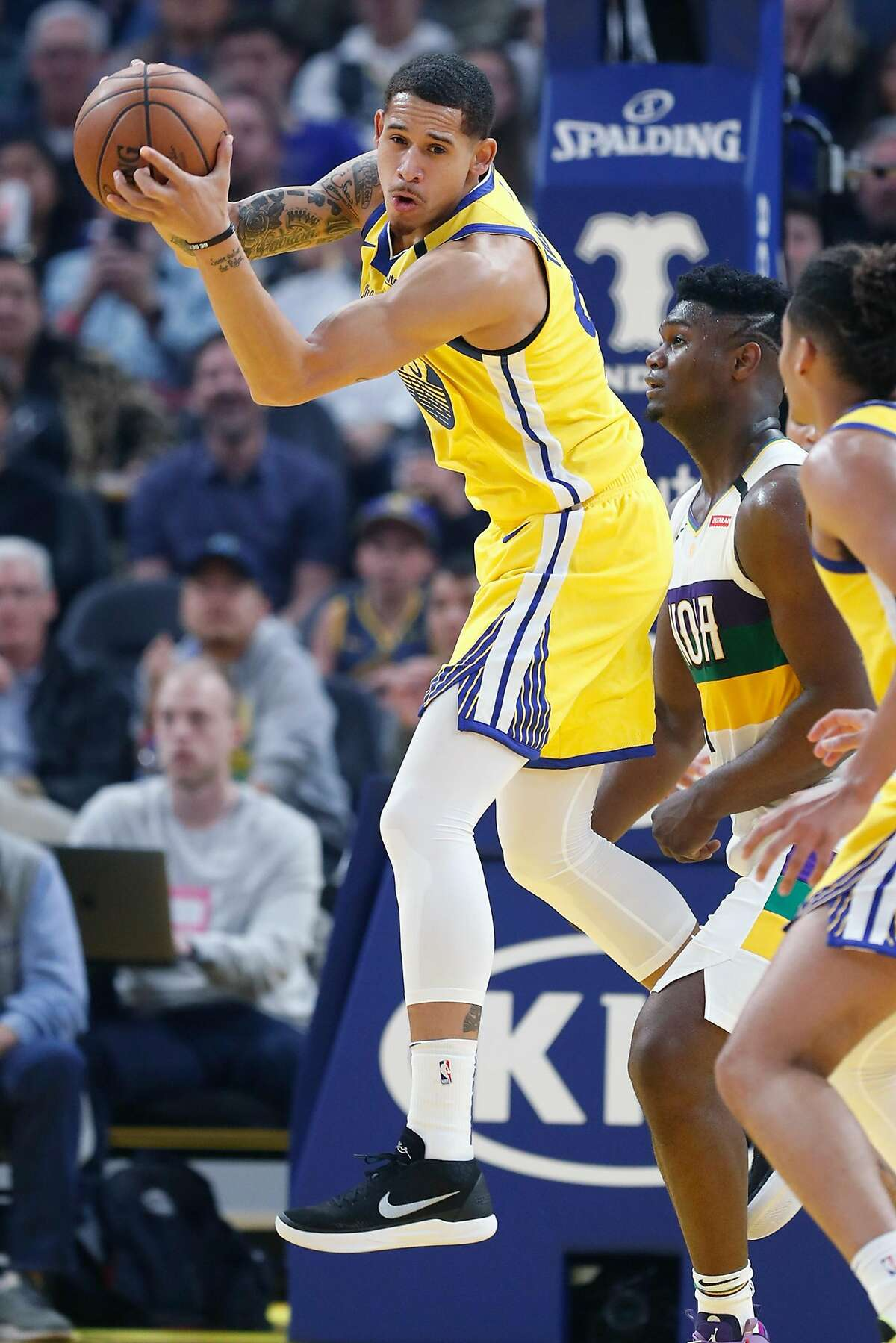 Golden State Warriors' Juan Toscano-Anderson rebounds in front of New Orleans Pelicans' Zion Williamson during Pelican's 115-101 win during NBA game at Chase Center in San Francisco, Calif., on Sunday, February 23, 2020.