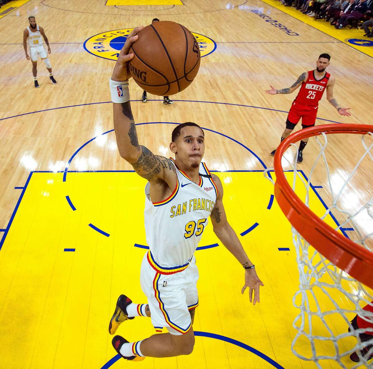 Juan Toscano-Anderson (95) dunks in the first half as the Golden State Warriors played the Houston Rockets at Chase Center in San Francisco, Calif., on Thursday, February 20, 2020.