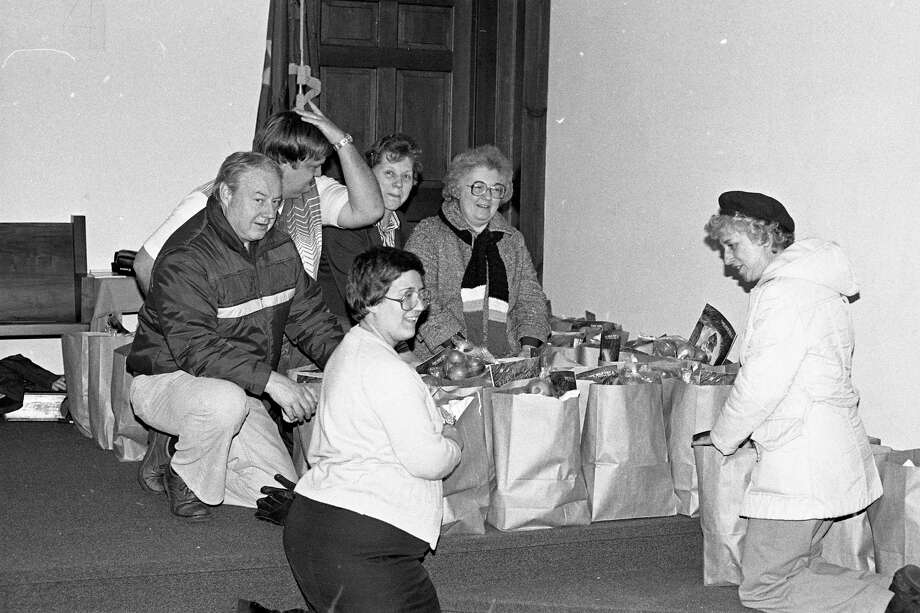 Members of The Salvation Army Advisory Board packed and distributed 230 Christmas packages to needy families 40 years ago today. (Manistee County Historical Museum photo)