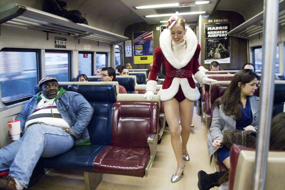 Katie Walker, a member of the world famous Rockettes, rides the southbound Metro-North train from Stamford to promote the railroad's