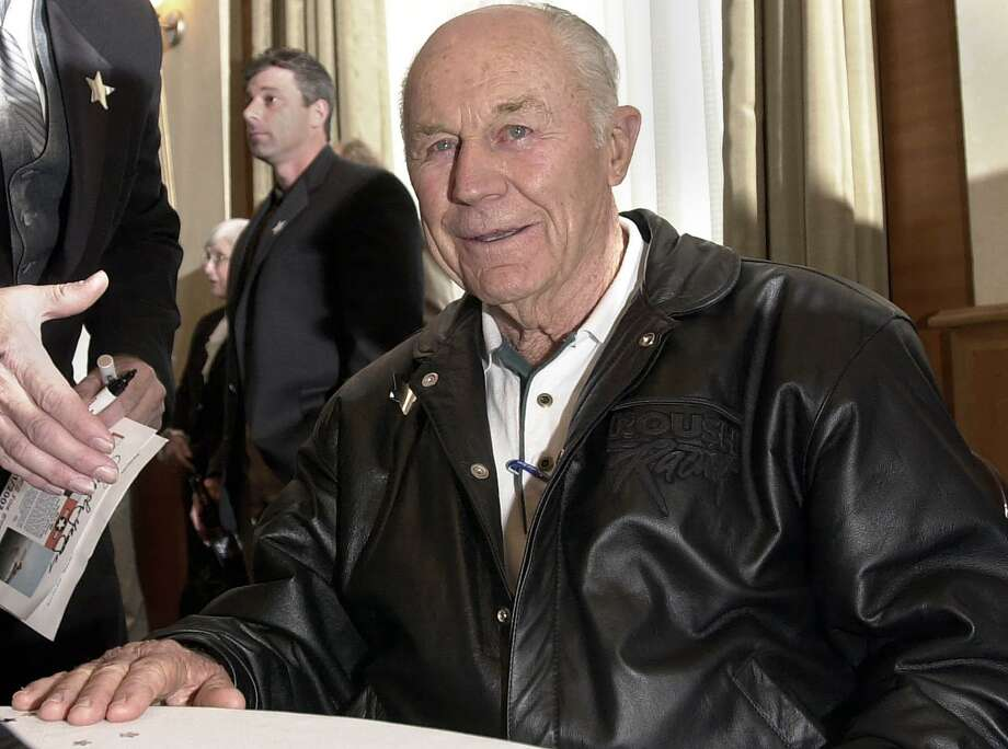 Yeager smiles while signing autographs during his 80th birthday celebration in Plano. Photo: LM OTERO, STF / AP / AP