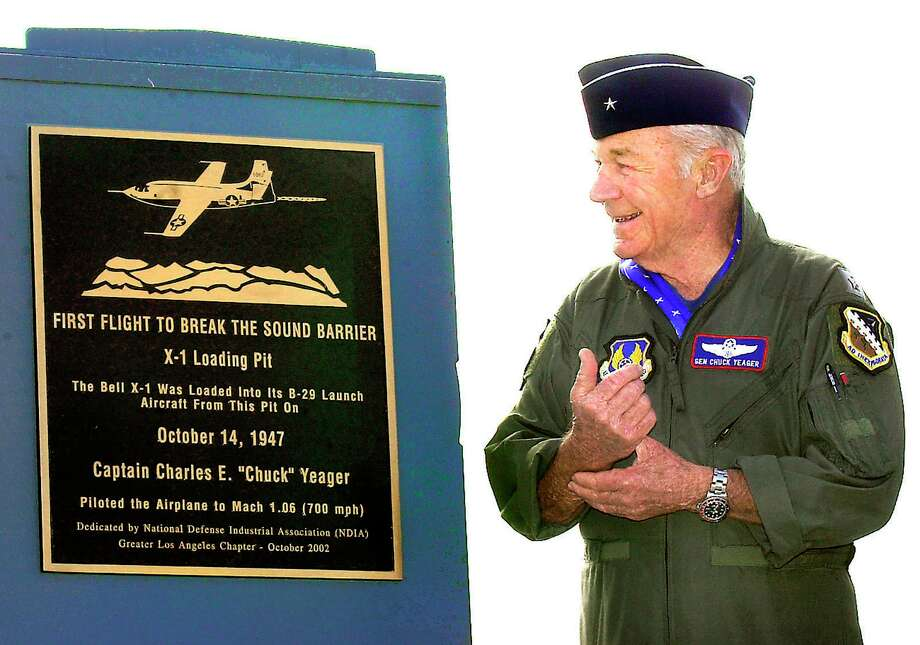 In this 2002 photo, retired Air Force Brig. Gen. Yeager receives a plaque from the National Defense Industrial Association, recognizing his breaking of the sound barrier and the use of X- 1 loading pit. Photo: Ron Siddle, MBR / Associated Press / AP2002