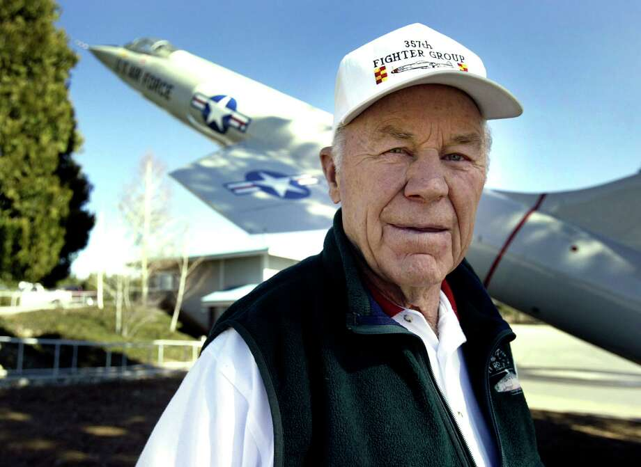In this 2004 photo, Chuck Yeager stands in front of an F-104 fighter jet that will be part of a monument in his honor at the Nevada County Airport. Photo: KIM KOMENICH, MBR / AP / SAN FRANCISCO CHRONICLE