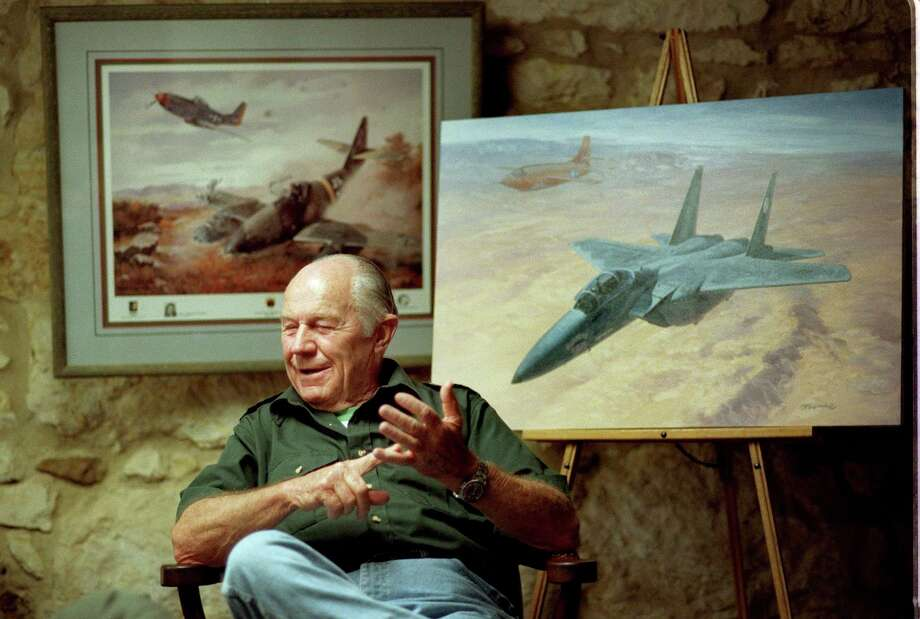 Yeager answers questions during a 1999 interview session in San Antonio. Behind him are paintings by Roy Grinnell depicting historic flights by Yeager. Yeager was in San Antonio to sign 1947 lithographs of the painting on the right, which commemorates his Oct. 14, 1947, flight in which he broke the sound barrier in the Bell X-1 (in the background of the painting) and his retirement flight fifty years later on Oct. 14, 1997, in an F-15. The lithograph on the left depicts Yeager's shooting down of a German P-51 in 1944. Photo: Robert McLeroy / SAN ANTONIO EXPRESS-NEWS