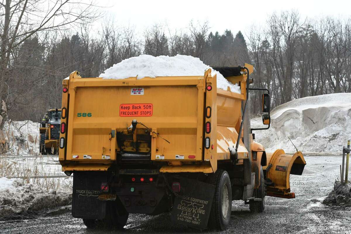 Snow cleared from the City of Albany is dumped at a South End site at the end of Binghamton Street on Tuesday, Dec. 22, 2020, in Albany, N.Y. (Will Waldron/Times Union)