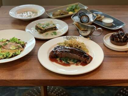 A spread of New Year's Eve options from San Francisco's One Market, including grilled steak, snapper and mushroom lasagna.