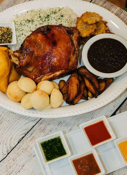 The holiday lechon platter from new San Francisco restaurant Chao Pescao comes with slow-cooked pork, plantains, beans and more.