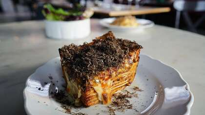 Che Fico's lasagna with bolognese gets a New Year's Eve boost from black truffle.