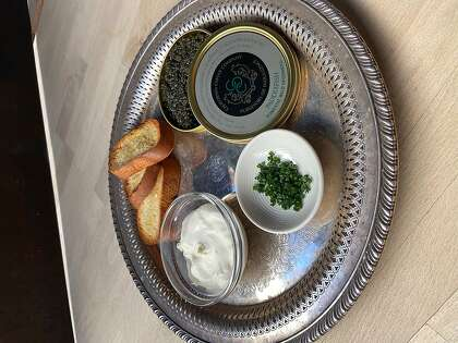 Caviar with creme fraiche and toast starts off the New Year's Eve feast from Oakland restaurant Homestead.