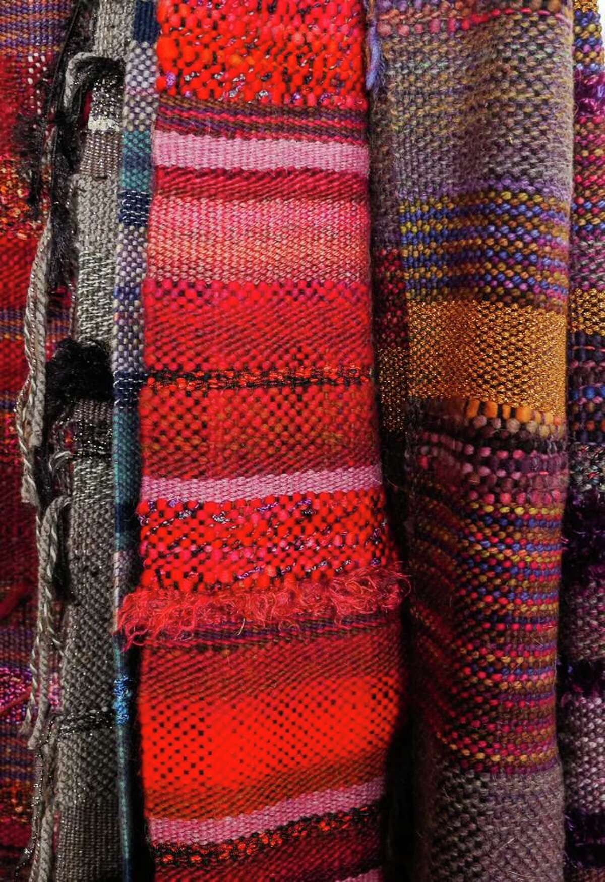 """Wool scarves by Leigh Graham, seen here, are among the handcrafted items on display at Gallery 25 in New Milford. There's pottery, paintings, photographs, jewelry, fused glass platters and more. The gallery is seeking artists for """"When the Snow Flies,"""" and through Jan. 9 will be giving away canvases, watercolor paper and pastel paper to visitors who would like to participate in its """"Spring Emergence"""" show. There's no fee to enter your creation."""