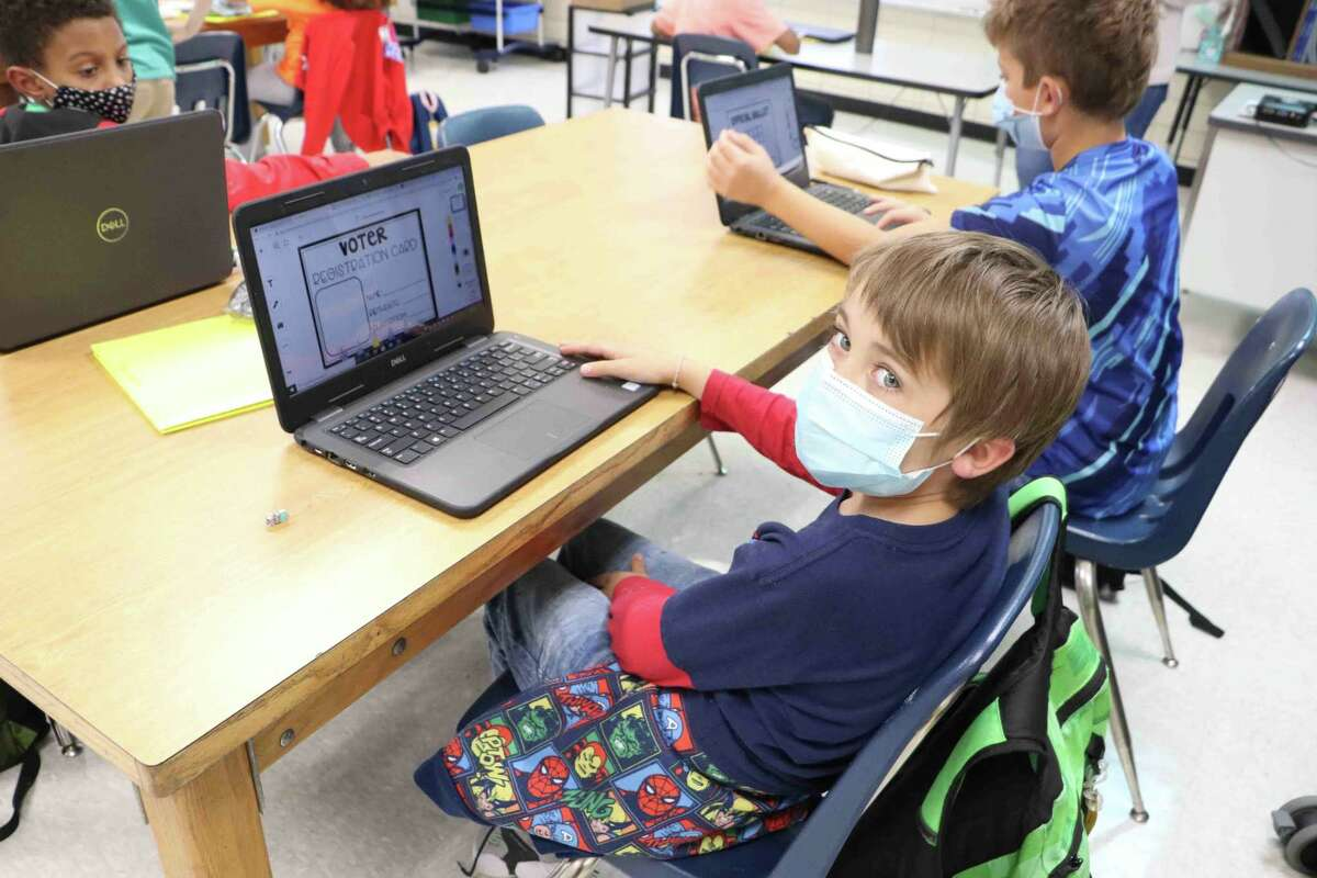 Noah Stevenson, a Lawhon Elementary School fourth-grader, participates in a mock election staged during the unique 2020 November election in which the pandemic forced local elections on the same date as state and national ones.