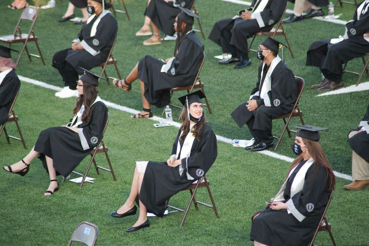 Carefully spaced to limit risk from the coronavirus, Shadow Creek High School seniors marked their graduation at Alvin ISD Freedom Field on June 4.