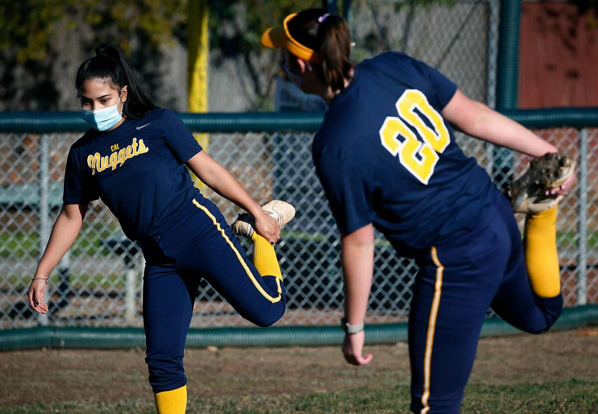 Washington High School softball player Maya Abrego (left) works out with Maddie Heinlin, a teammate from her Cal Nuggets independent club team in Fremont, Calif. on Saturday, Dec. 19, 2020.
