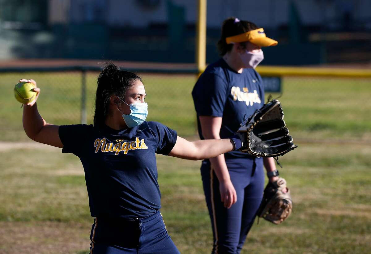 Washington High School softball player Maya Abrego fields grounders with teammate Maddie Heinlin (right) from her Cal Nuggets independent club team in Fremont, Calif. on Saturday, Dec. 19, 2020.