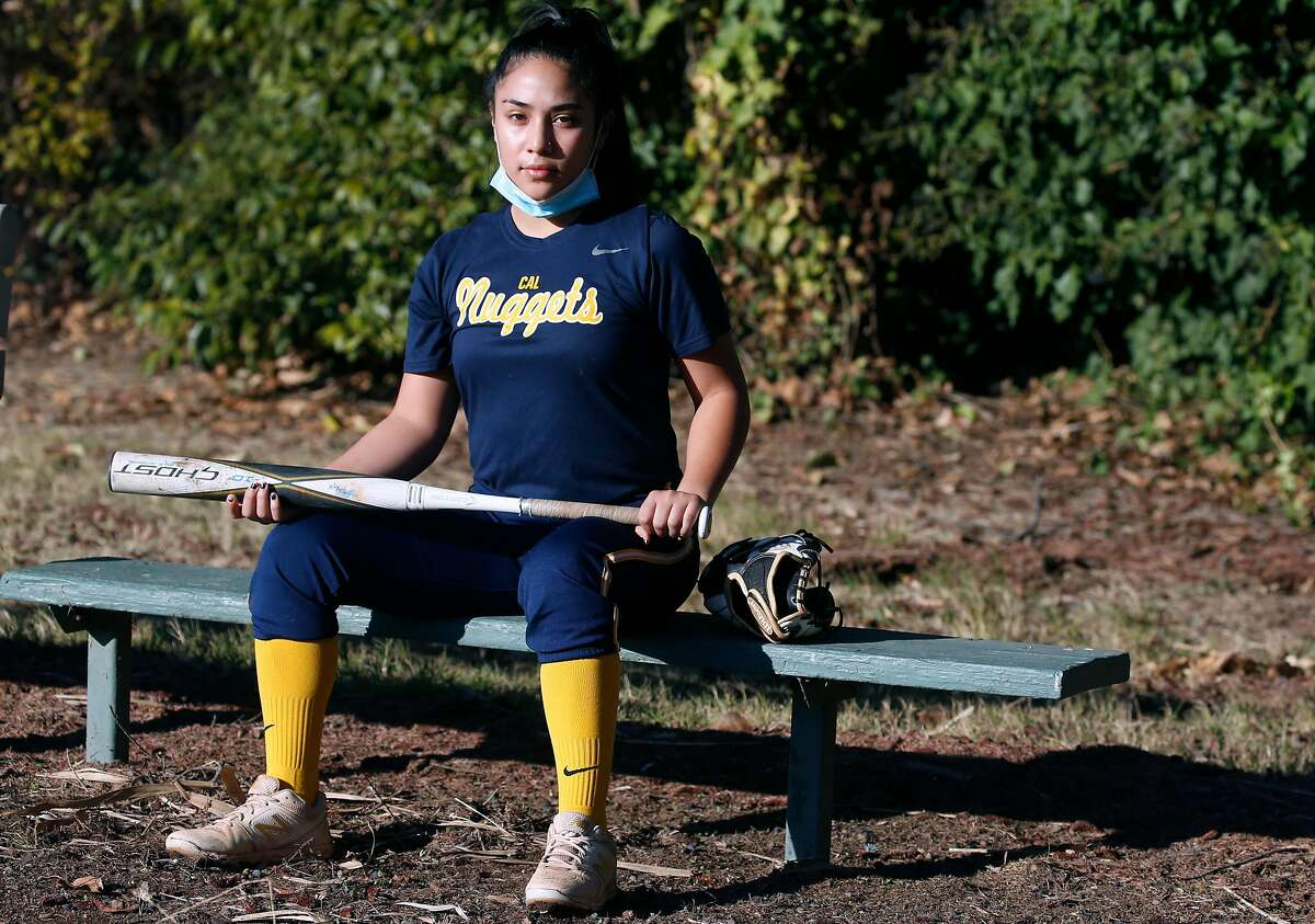 Washington High School softball player Maya Abrego works out with teammates from her Cal Nuggets independent club team in Fremont, Calif. on Saturday, Dec. 19, 2020.