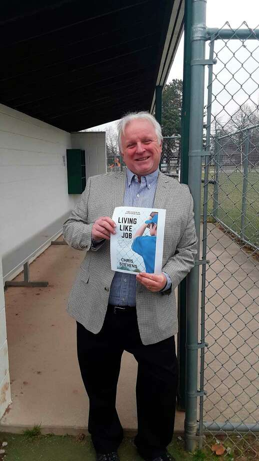 """Midland author Chris Stevens shows the cover of his newest book, """"Living Like Job."""" (Dan Chalk/chalk@mdn.net)"""