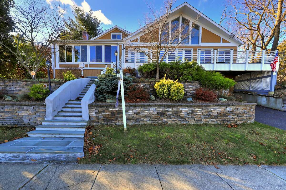 The contemporary house at 129 Rogers Avenue, Milford is within walking distance of the Green, Metro North Railroad train station, shops and restaurants.