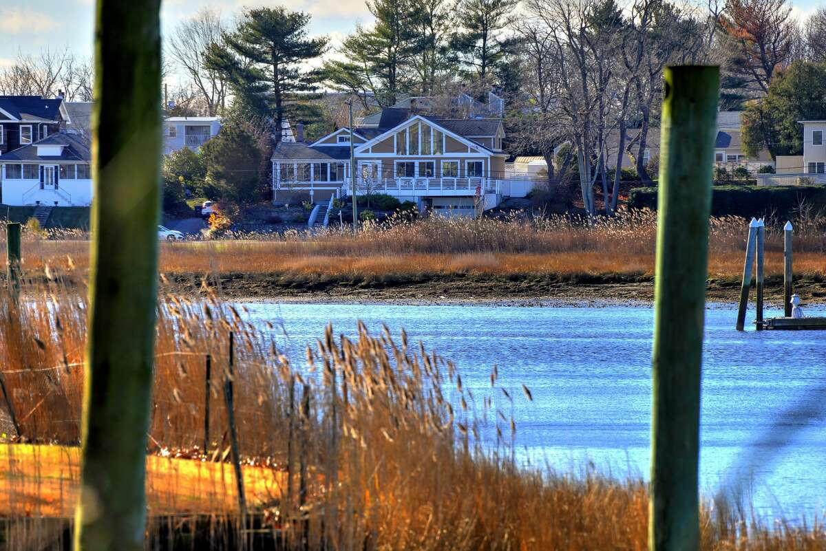 The contemporary house at 129 Rogers Avenue, Milford, as seen from Milford Harbor. The house sits across the street from Milford Harbor.
