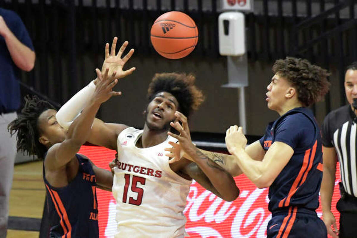 Rutgers center Myles Johnson (15) is pressured by Illinois guard Ayo Dosunmu, left, and Illinois guard Jacob Grandison and forward Coleman Hawkins (33) during the first half of an NCAA college basketball game Sunday, Dec. 20, 2020, in Piscataway, N.J.