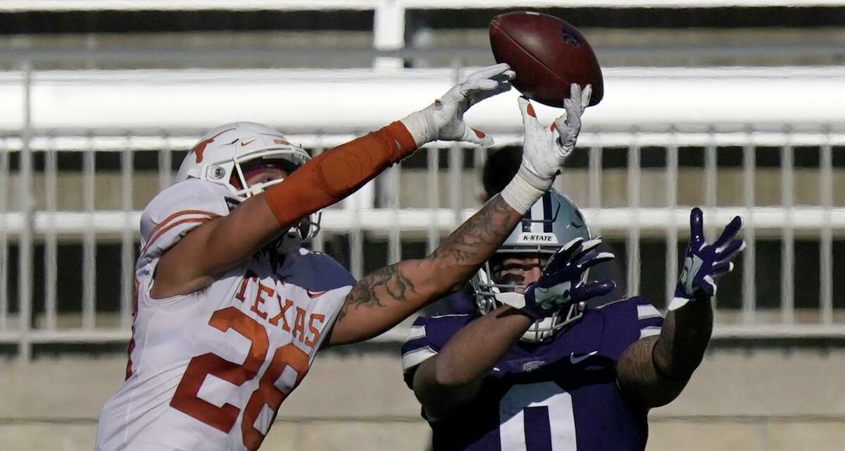 Texas freshman Jerrin Thompson, breaking up a pass intended for Kansas State's Briley Moore, could see more action in the Alamo Bowl.