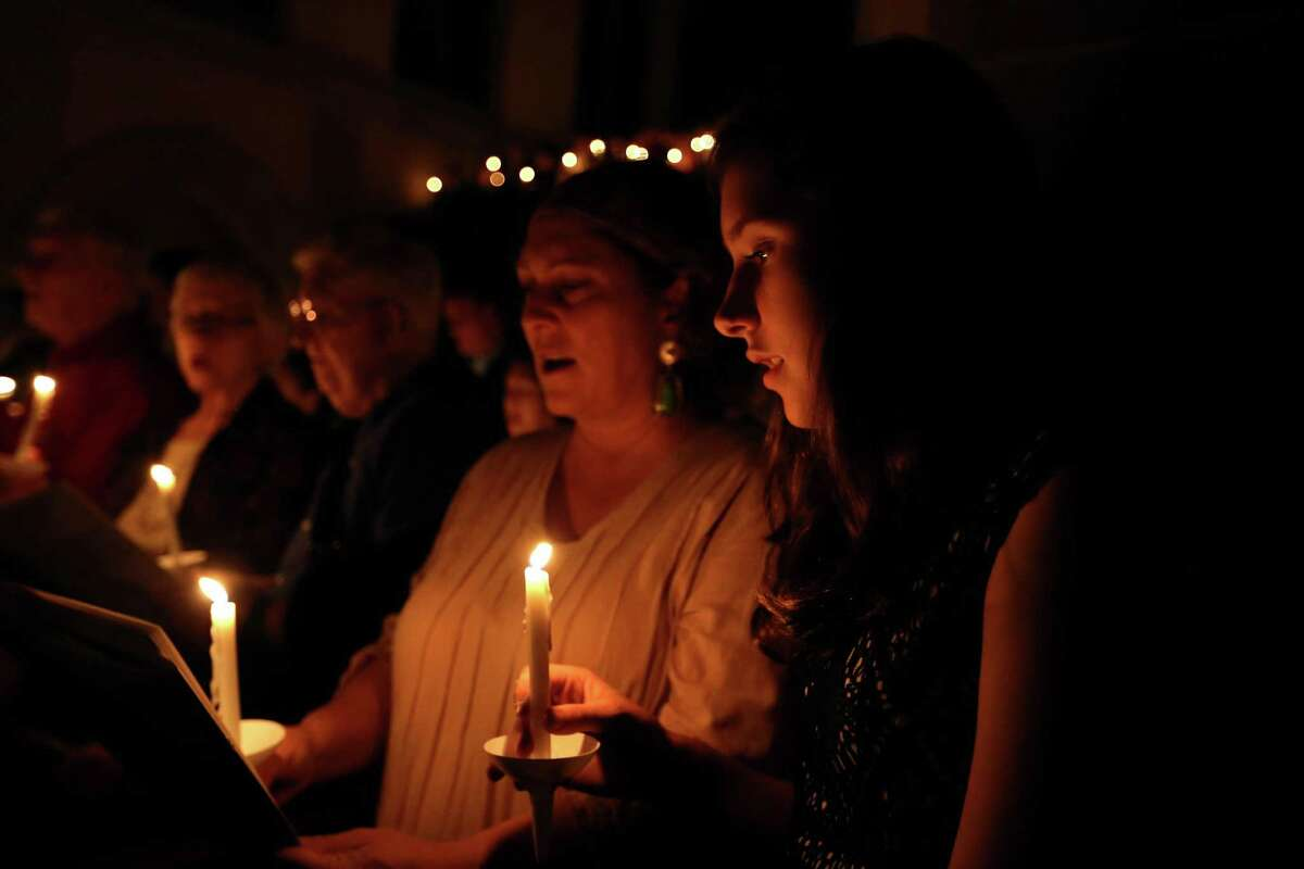 """Church goes participate in a candle lighting during the singing of """"Silent Night"""" in the Christmas Eve service at St. Paul's United Methodist Church Thursday, Dec. 24, 2015, in Houston, Texas. The Christmas celebration commemorates the birth of Jesus of Nazareth, who many fist-century Palestinians and others recognized as the long awaited Messiah spoke of by the prophets of Israel and Judah. ( Gary Coronado / Houston Chronicle )"""
