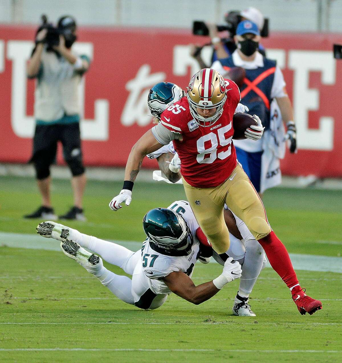 George Kittle (85) evades a tackle by T. J. Edwards (57) In the first half as the San Francisco 49ers played the Philadelphia Eagles at Levi's Stadium in Santa Clara, Calif., on Sunday, October 4, 2020.