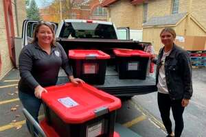 In this file photo, volunteers with Angels of Action helped deliver food to Reed City and Evart schools during the COVID-19 pandemic. (Courtesy photo)