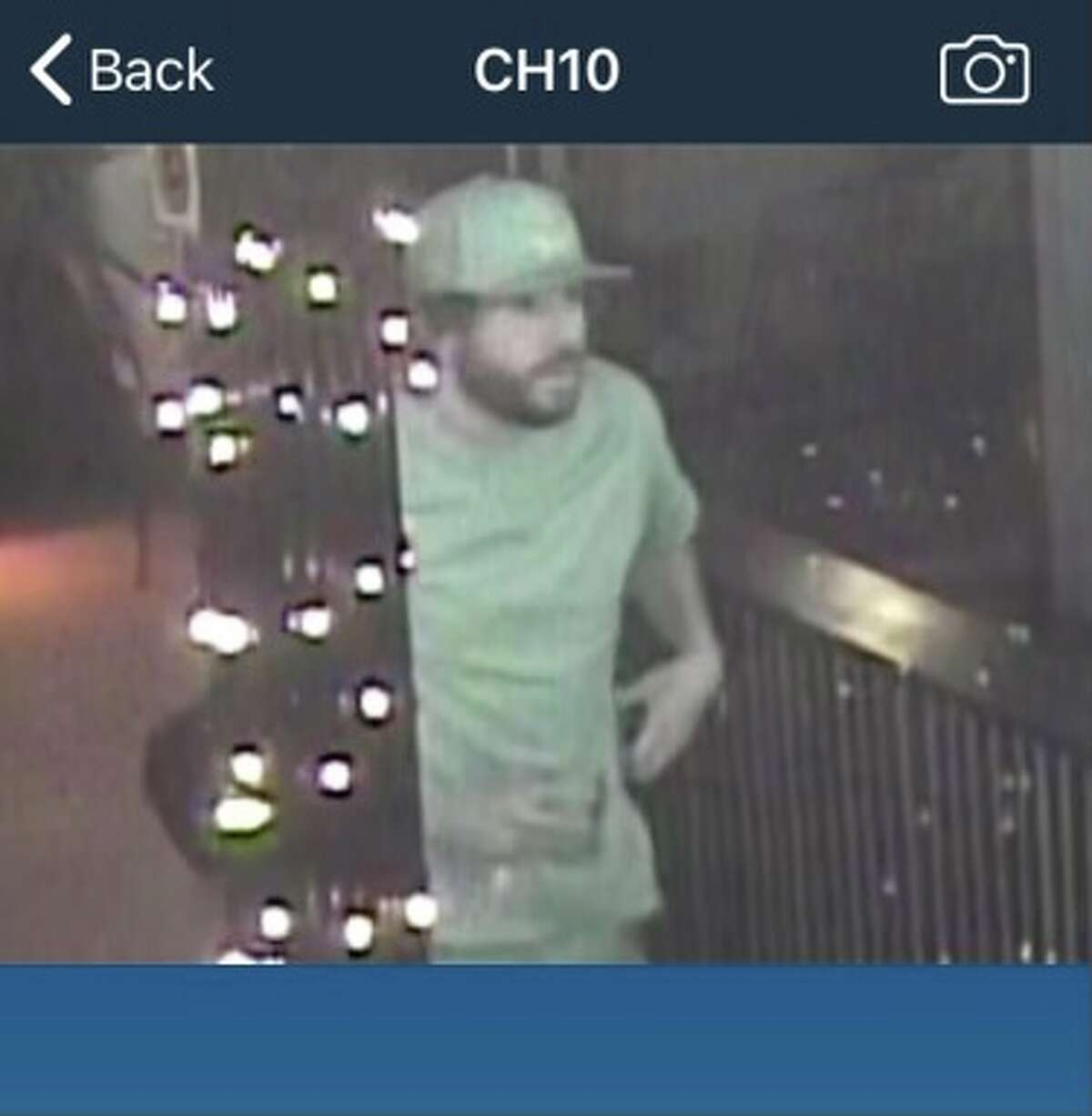 Surveillance photos show the customer who allegedly assaulted a Grand Prize Bar employee.