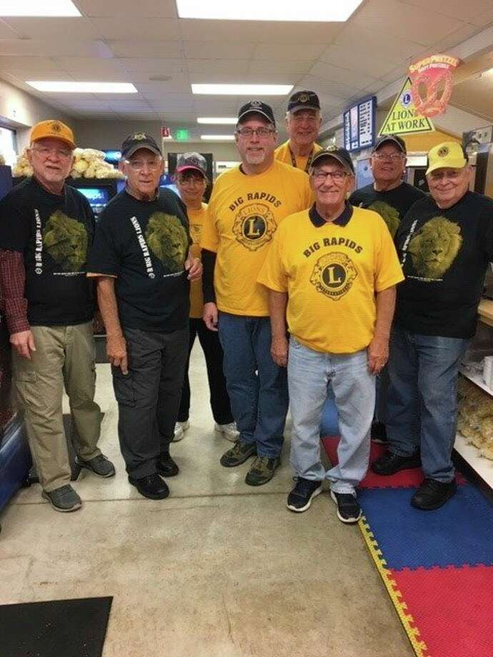 Lions club members pause for a photo during a past football season while working in the Top Taggart Field concession stand. (Courtesy photo)