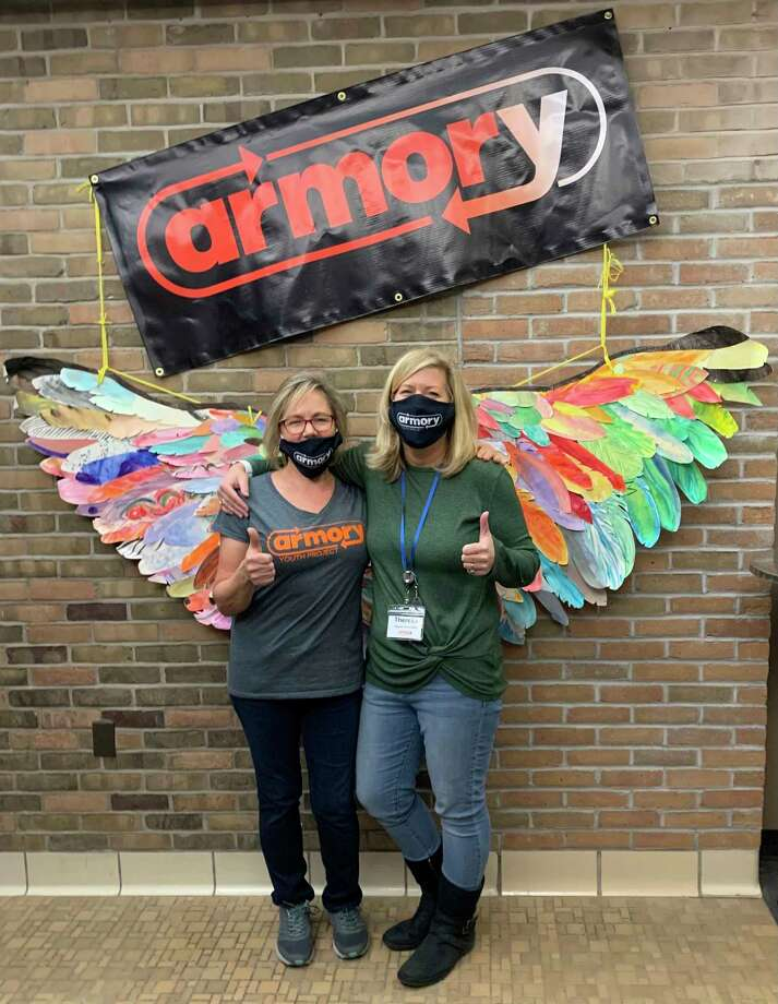 """In early December, the Armory Youth Project celebrated the """"angels of the Armory"""". Pictured (from left) areAmy Wojciechowski, Armory executive director, andTheresa Anderson,assistant executive director. (Courtesy photo)"""