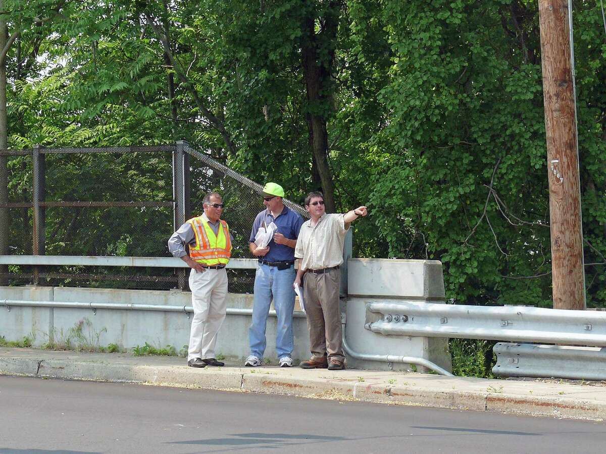 Officials discuss some of the issues with the traffic signals at Grasmere Avenue and Kings Highway East in 2011.