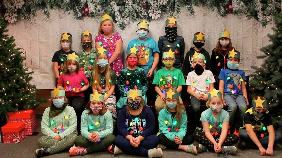 """The third grade class of Bear Lake Schools sings """"O Christmas Tree"""" as part of a virtual Christmas concert video put together so the community could enjoy the annual winter sing without congregating. (Screenshot/YouTube)"""
