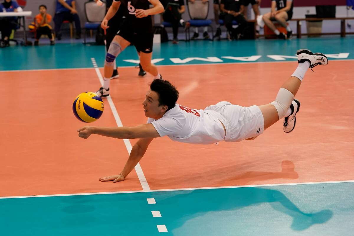 Stanford volleyball player Justin Lui playing for Canada