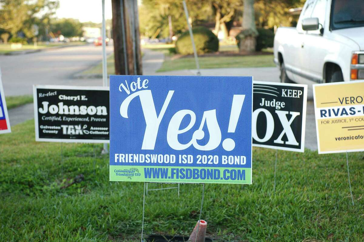 A campaign sign encourages voters to pass the 2020 Friendswood ISD school bond on Election Day. the $128.3 million package to fund multiple school constructino projects was approved.