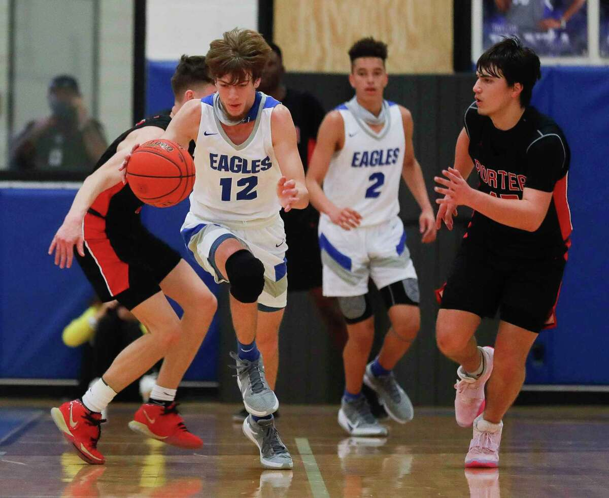 New Caney shooting guard Samuel Brandon (12) starts a fast break after stealing the ball during the fourth quarter of a District 20-5A high school basketball game at New Caney High School, Tuesday, Dec. 22, 2020, in New Caney.