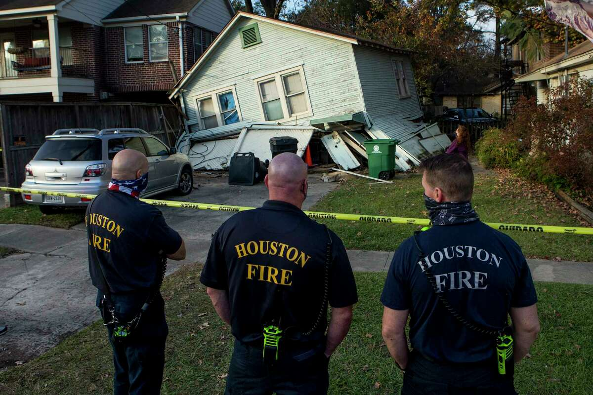 Houston firefighters stand by at the scene of a building collapse near the intersection of Usener and White Oak Tuesday, Dec. 22, 2020 in Houston.