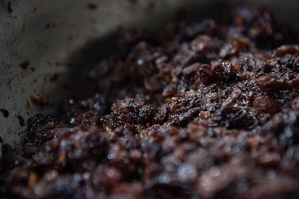 June Taylor dries grapes over the span of six weeks, to create just one component of her popular Christmas cakes.