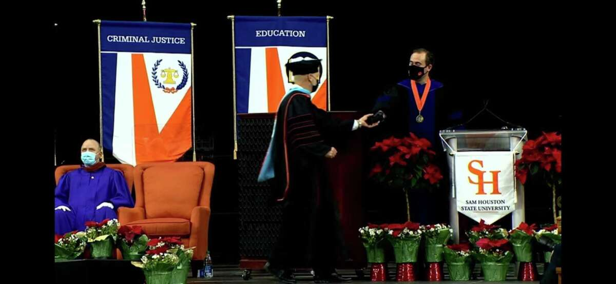 Willis Independent School District Tim Harkrider receives his doctorate in educational leadership from Sam Houston State University on Saturday at NRG Stadium.