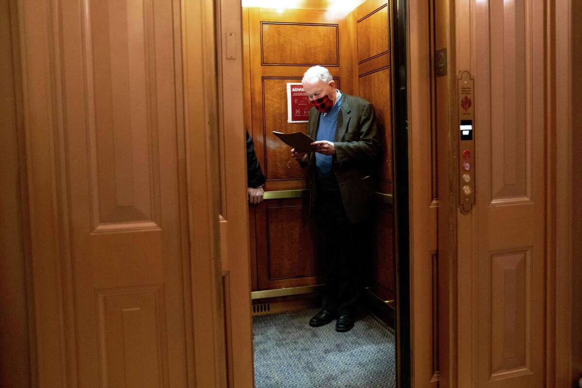 Sen. Lamar Alexander (R-Tenn.) boards an elevator at the Capitol in Washington, Dec. 14, 2020. After years of being stymied by well-funded interests, Congress has agreed to ban one of the most costly and exasperating practices in medicine: surprise medical bills.