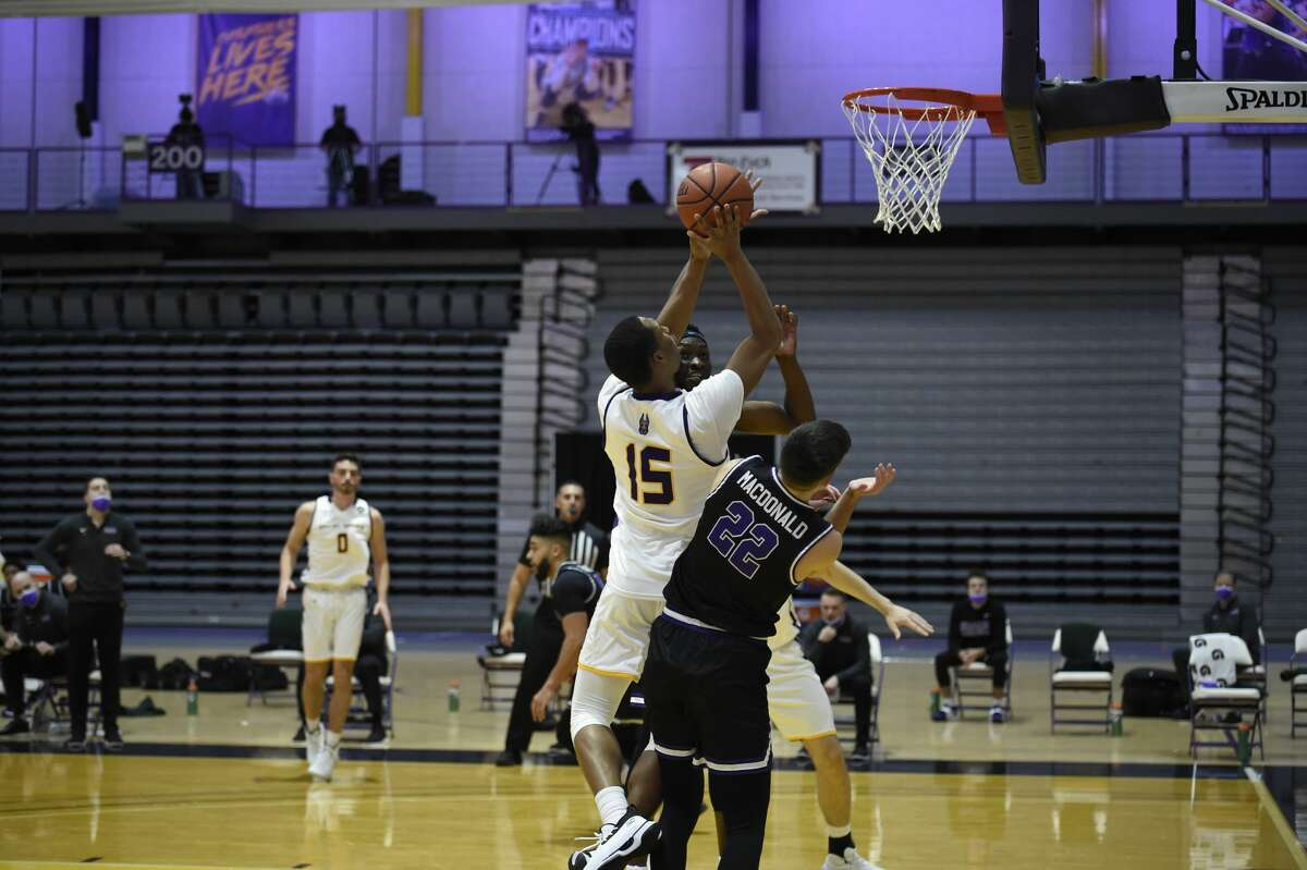 UAlbany guard C.J. Kelly shoots over Niagara's Nick MacDonald during a nonconference college basketball game Tuesday, Dec. 22, 2020, at SEFCU Arena. (Kathleen Helman)