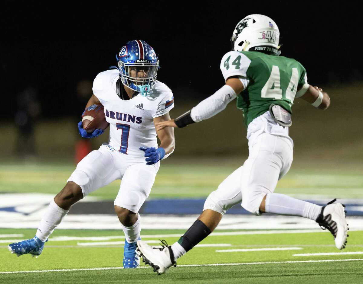 Jamichael Foxall (7) of the West Brook Bruins runs around right end in the first half and makes an attempt to get away from Kannon Garza (44) of the Clear Falls Knights during a High School football playoff game on Friday, December 18, 2020 at GPISD Stadium in Houston, Texas.