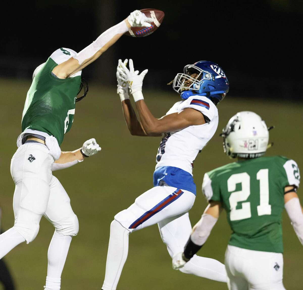 Max Williams (5) of the Clear Falls Knights knocks the ball away from Ja'Von Sorrell (18) of the West Brook Bruins in the second half during a High School football playoff game on Friday, December 18, 2020 at GPISD Stadium in Houston, Texas. On Thursday, Williams knocked down a fourth-down pass with 1:12 remaining in the game to lift Clear Falls to a 10-9 win over Katy Taylor.
