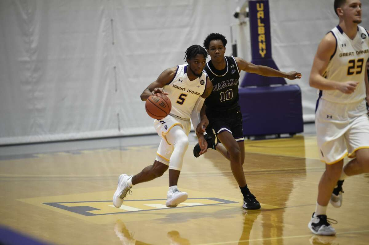 UAlbany guard Jamel Horton, left, says the team was ready to play when it found out the game against St. Joseph's had been added. (Kathleen Helman / UAlbany Athletics)