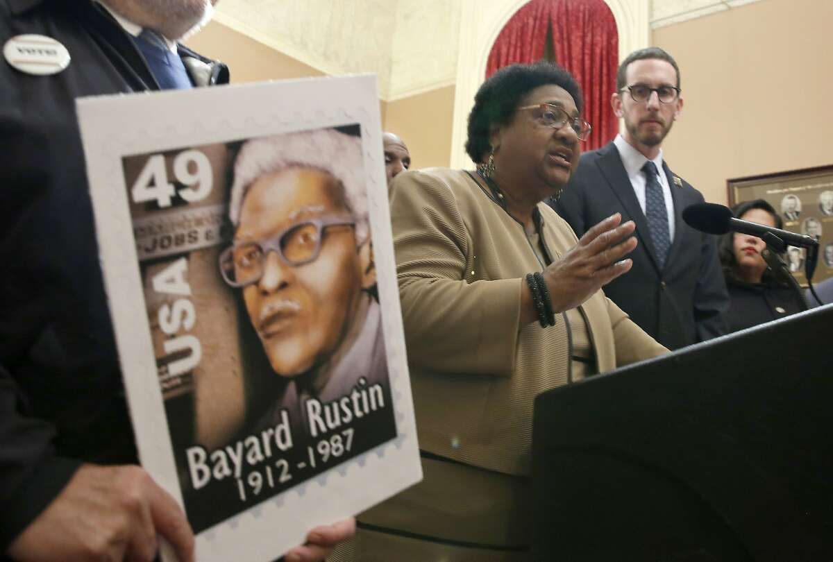 Assembly member Shirley Weber, D-San Diego, center, and state Sen. Scott Wiener, D-San Francisco, at a Jan. 21 news conference in Sacrameto where they called on Gov. Gavin Newsom to posthumously pardon civil rights leader Bayard Rustin, who was jailed for having gay sex nearly 70 years ago. On Tuesday, Newsom said he would nominate Weber for secretary of state.