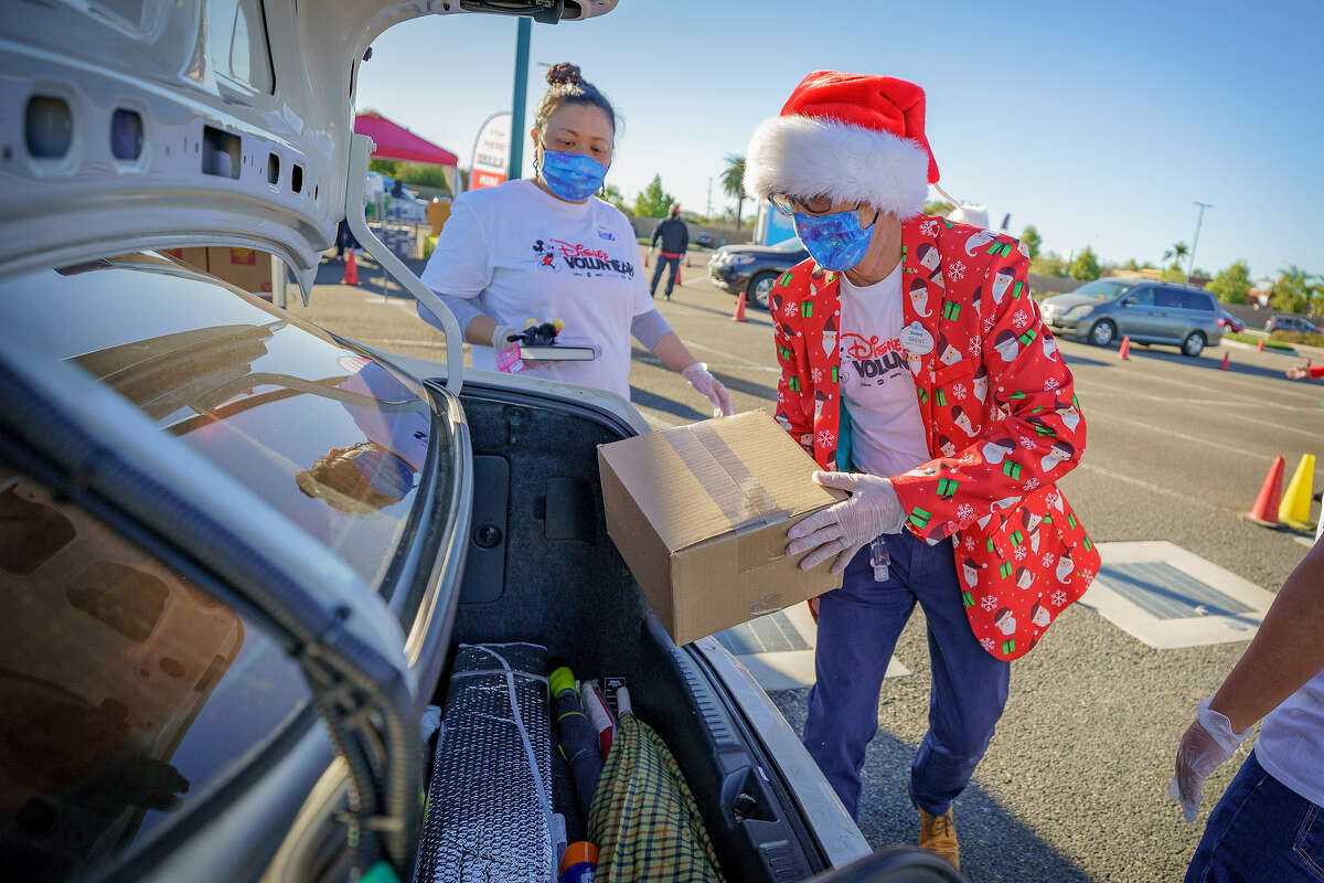 Volunteers deliver food donations at Disneyland on December 21, 2020.