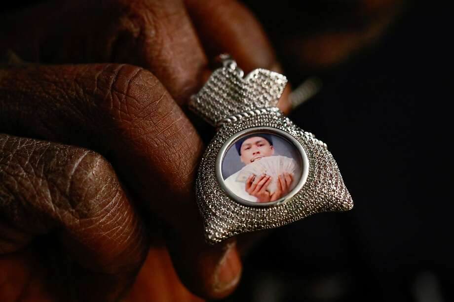 "Joseph Alexander shows a necklace with a photo of son Joseph ""Bunkin"" Alexander II, who was slain in San Pablo in 2018. Photo: Gabrielle Lurie, The Chronicle"